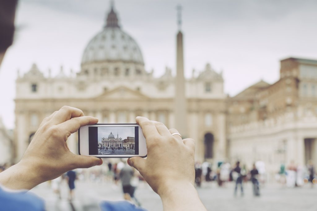 Rome, Italy - September 2, 2015: Young man is taking pictures about the St. Peter's Basilica. Rome,